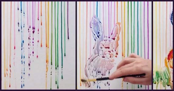 Hun drypper maling på et lerret og bruker penselen. Sluttresultatet er helt nydelig!